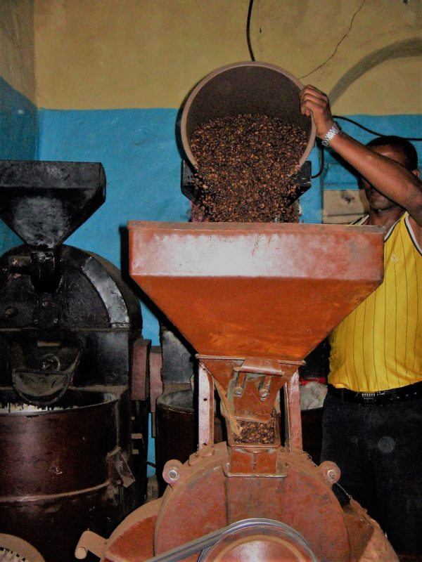 Grinding of the coffee beans the traditional way